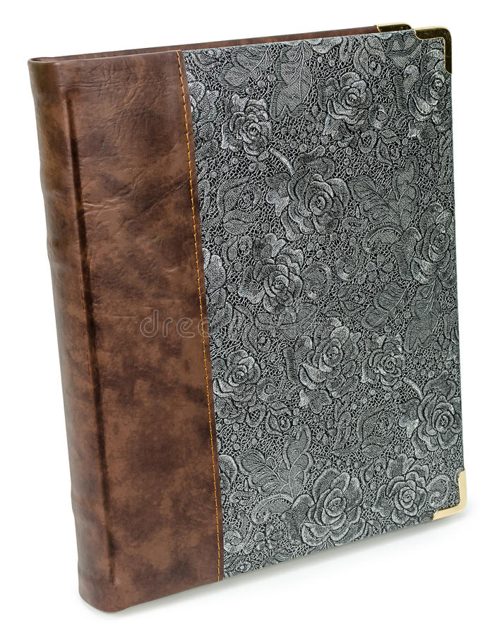 Photo album with eco leather ant textile floral pattern Silver luxury lace texture book with roses. Isolated background stock photo