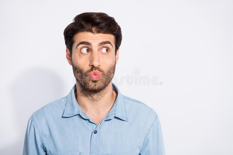 Photo of amazing arab macho guy looking empty space sending air kiss wondered if it was received wear casual denim shirt royalty free stock photos