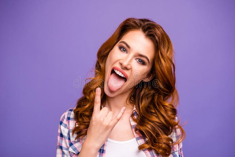 Photo of amazing ginger lady at rock concert showing horns sticking tongue out mouth wear casual plaid shirt isolated. Photo of amazing ginger lady at rock royalty free stock photos