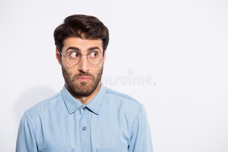 Photo of amazing indian guy looking side empty space feel guilty for awful situation wear specs casual denim shirt stock photography