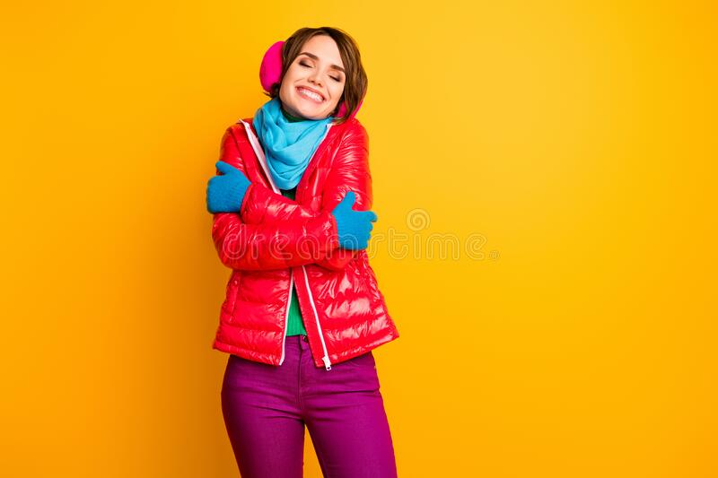 Photo of amazing lady enjoy warm coat in cold frosty weather hug herself wear stylish casual short red overcoat blue. Photo of amazing lady enjoy warm coat in royalty free stock photography