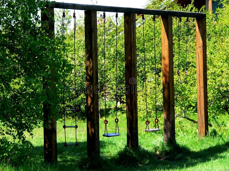 Download Photo With The Architectural Construction Of Wooden Swings Made Of Natural Timber Stock Photo - Image: 83715862