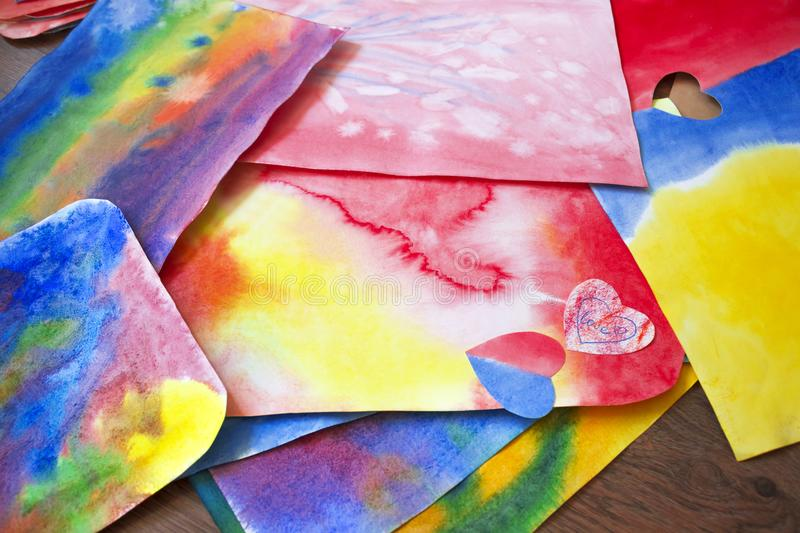 A photo of the artistic hand drawn abstract wet watercolor background, waldorf colorful template and a pencil. A lesson of drawing. In Waldorf Steiner school royalty free stock images