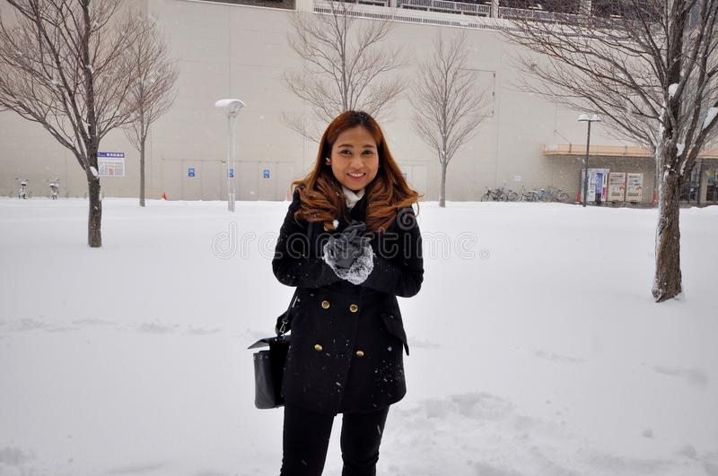 An asian woman with snow environment in Sapporo city, Japan January 21,2018. Photo of an asian woman with snow environment in Sapporo city, Japan January 21,2018 royalty free stock image