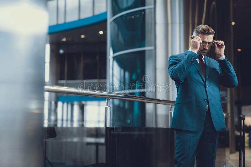 Handsome man wearing eyewear in business center royalty free stock photography