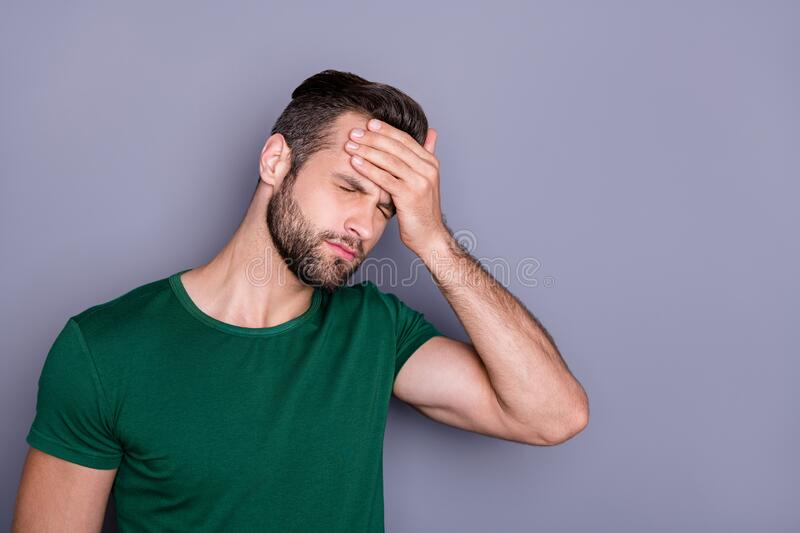 Photo of attractive handsome guy hold hand on forehead fever eyes closed grimacing caught cold corona virus temperature. Photo of attractive handsome guy hold stock photos