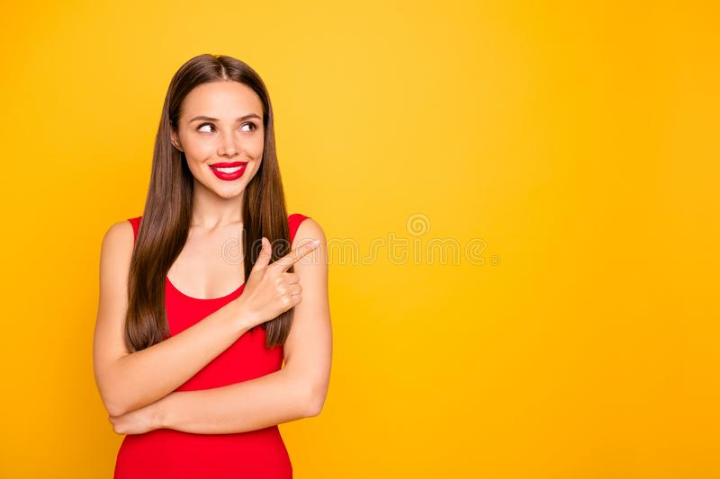 Photo of attractive lady bright look indicating fingers empty space advising cool sale discount wear red swimming suit. Photo of attractive lady bright look stock image