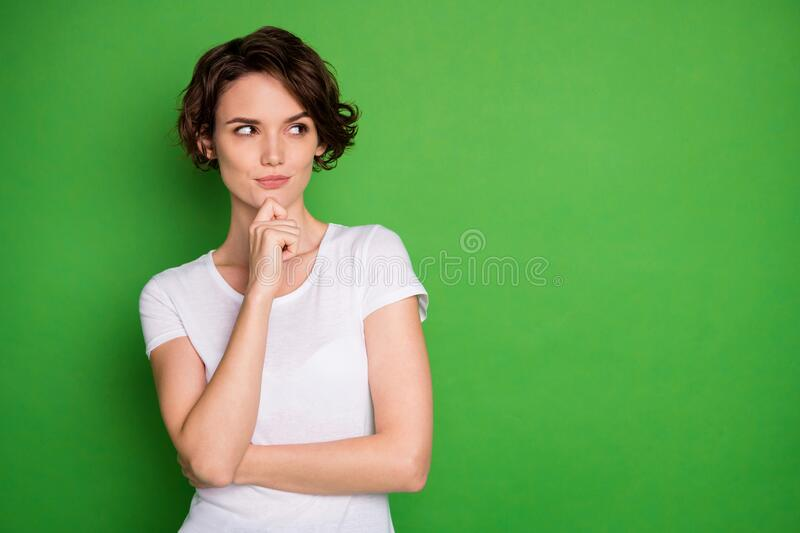 Photo of attractive lady short wavy hairdo look interested side empty space have creative idea crazy cunning eyes sly. Photo of attractive lady short wavy hairdo royalty free stock photo