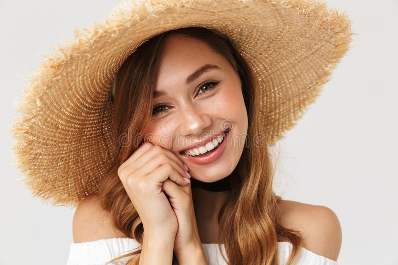 Photo of attractive woman 20s wearing big straw hat looking at c stock photo