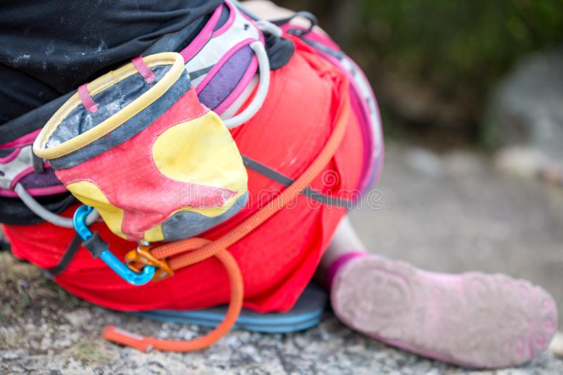 Photo from back of rock climber with backpack and bag with talp near mountain stock images
