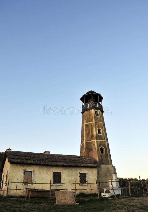 Old wooden lighthouse in the shore stock image