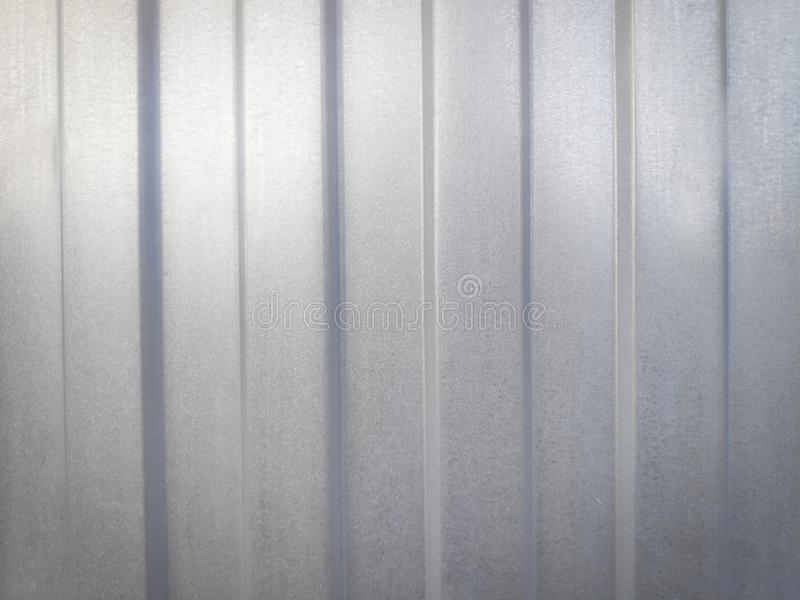 Photo background image of a metal profiled sheet of gray color with highlights for use in advertising stock image