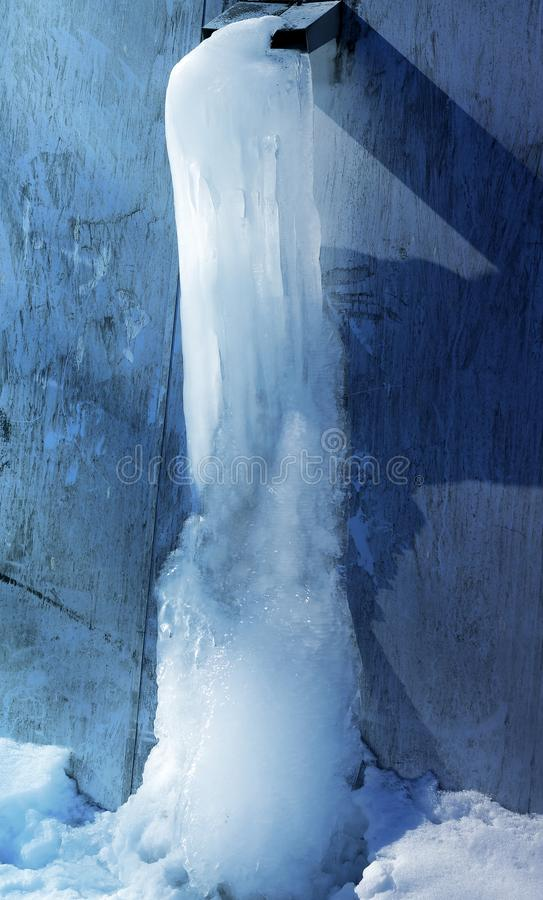 Photo background macro frozen water from a pipe. In the street royalty free stock photography