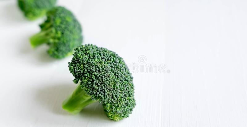 Photo for banner with broccoli. Diet banner. Photo of broccoli on a white wooden background. Vegans, organic food. Diet stock photo