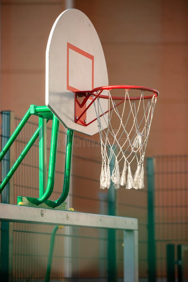Photo of basketball hoop in gym. Indoors stock images