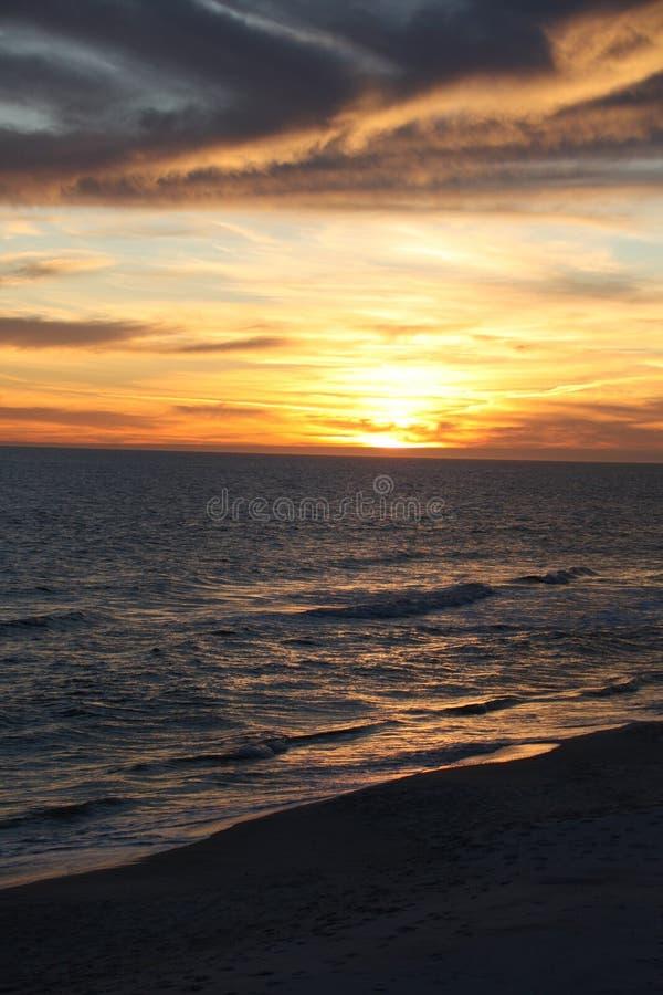 Photo of beach and ocean at sunset. stock photos