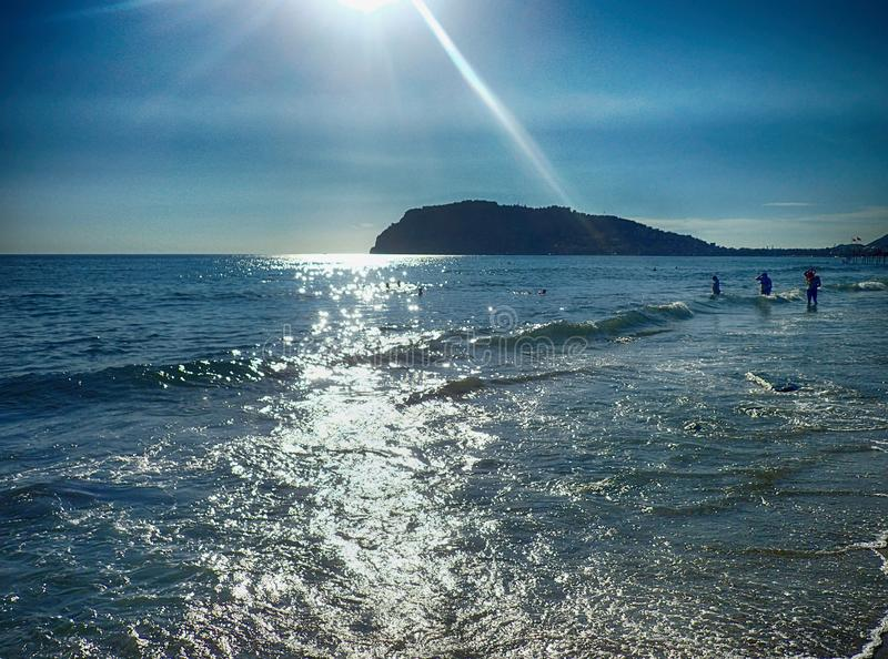 Photo of a beach in Turkey in Alanya on a beautiful summer day stylized as an old photographA beautiful photo of a beach in. A beautiful photo of a beach in royalty free stock image