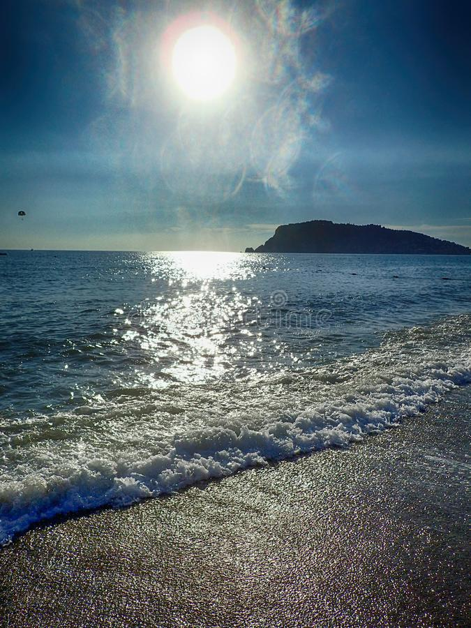 Photo of a beach in Turkey in Alanya on a beautiful summer day stylized as an old photographA beautiful photo of a beach in. A beautiful photo of a beach in stock photos