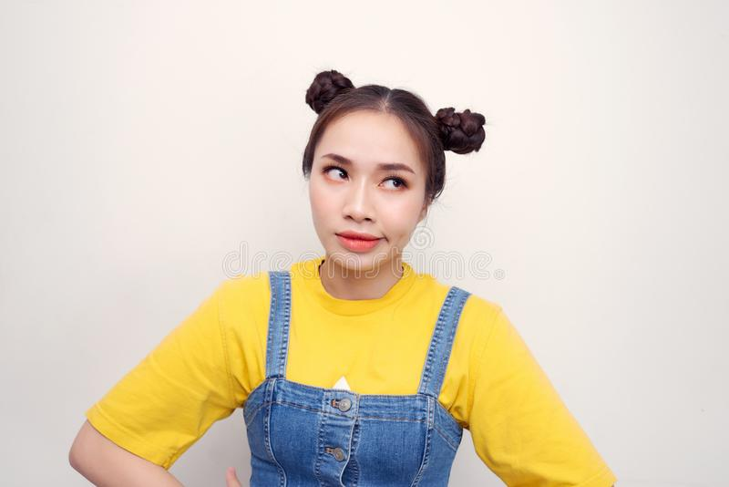 Photo beautiful amazing she her lady two buns red lipstick pomade what`s wrong with you facial expression isolated white. Background stock photo