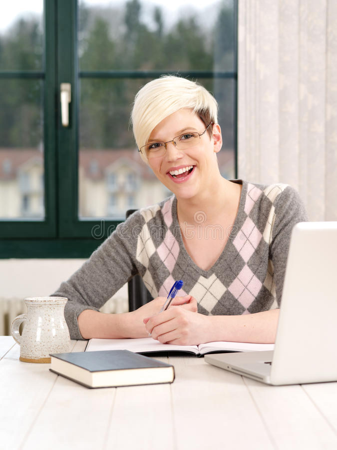 Smiling female office worker stock image