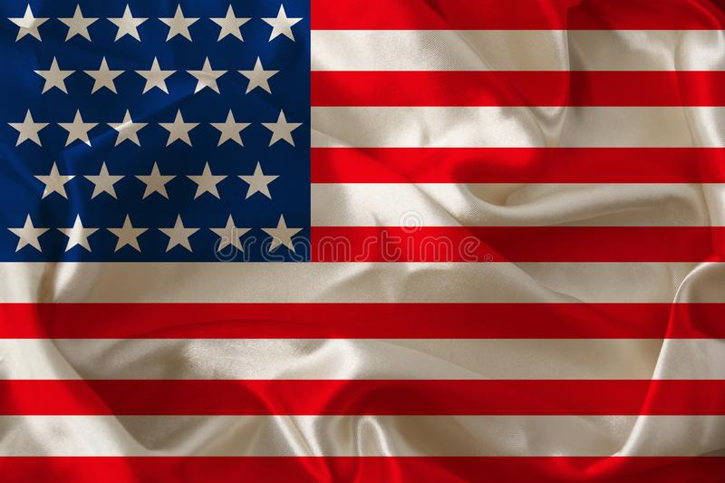Photo of the beautiful colored national flag of the modern state of USA on textured fabric, concept of tourism, emigration,. Economics and politics, closeup stock images
