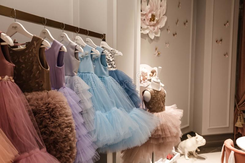Beautiful dresses in decorated showroom royalty free stock images
