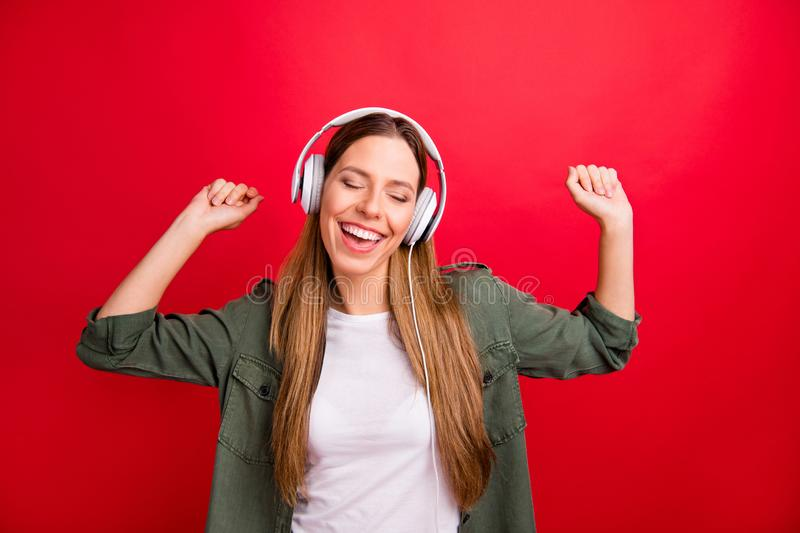 Photo of beautiful nice attractive charming music lover dancing wearing earphones while isolated with red background stock photos