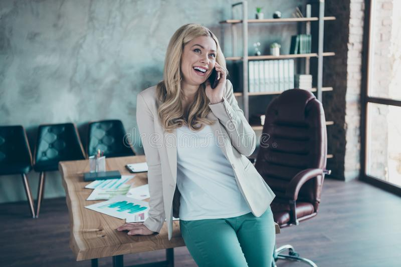Photo of beautiful positive business lady chief hold telephone speaking with partners corporate discussion startup royalty free stock image