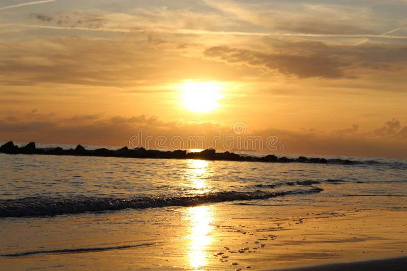 The beautiful sunset on the beach. royalty free stock photo