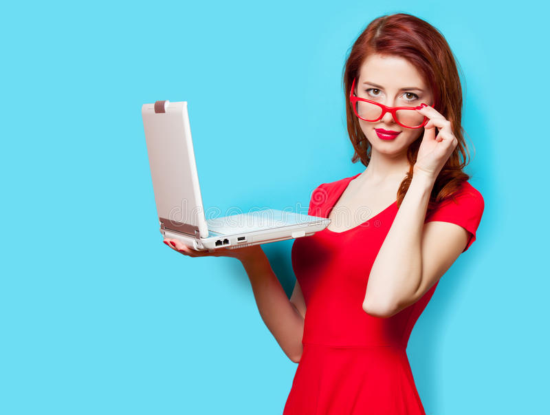 Photo of beautiful young woman holding laptop on the wonderful b. Lue studio background royalty free stock photography