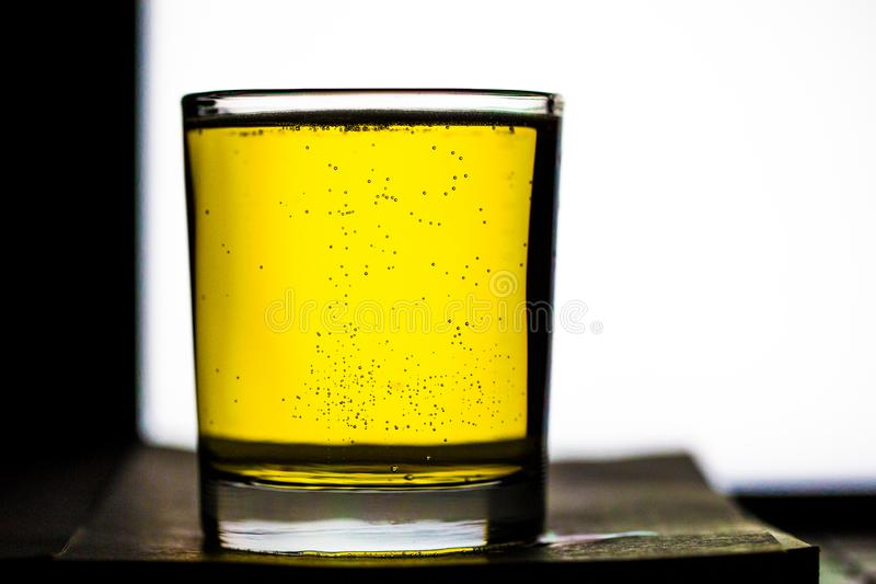 Photo of Beer and bubbles. It is a photo of Beer and bubbles.A slightly bitter alcoholic beverage made from barley malt and hops; especially one brewed by bottom stock photos