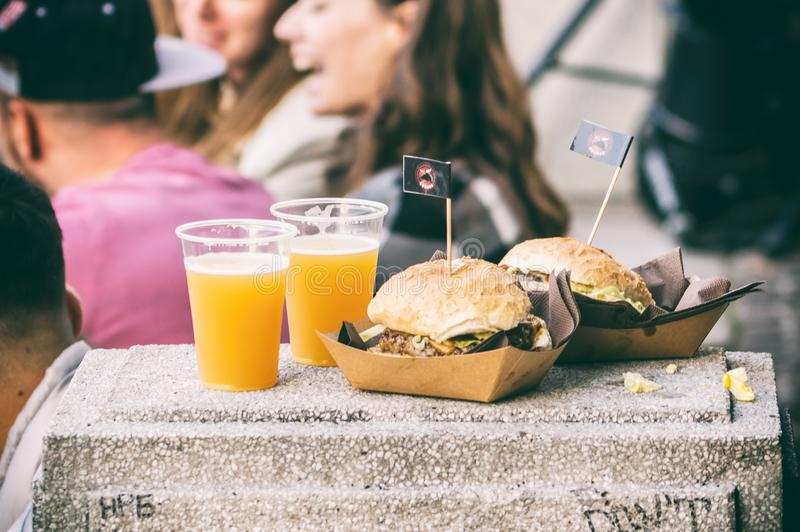 Beer and burger at open food market in Ljubljana, Slovenia. Photo of beer and burger can be used for any organic food or open market and gourmet purposes stock image