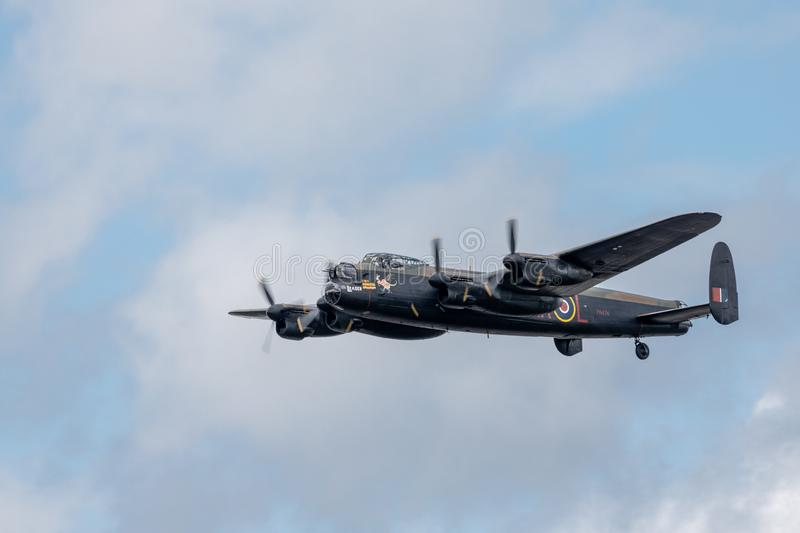 Clean photo of a lancaster bomber flying past in the skies above the UK. Photo from the Biggin Hill air show 2019. Clean photo as the Lancaster bomber does a fly royalty free stock photos