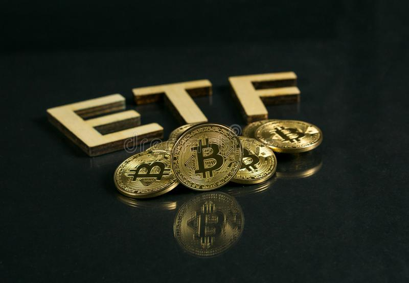 Bitcoin coin with ETF text Put on wooden floor, Concept Entering the Digital Money Fund. Photo of Bitcoin coin with ETF text Put on wooden floor, Concept royalty free stock image