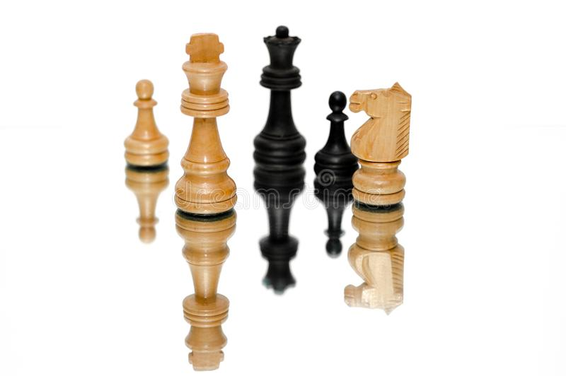 Photo of Black and Beige Wooden Chess Pieces With White Background royalty free stock image