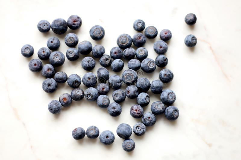 Photo of Black Berries on White Surface stock photo