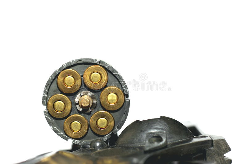 Photo of black revolver gun with cartridges isolated on white background. Close-up stock image