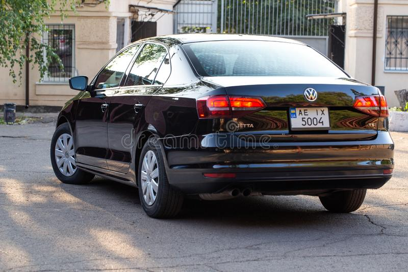 Photo of black Volkswagen Jetta in the yard. KRIVOY ROG, UKRAINE - JULY 28, 2019: Photo of black Volkswagen Jetta in the yard stock photos