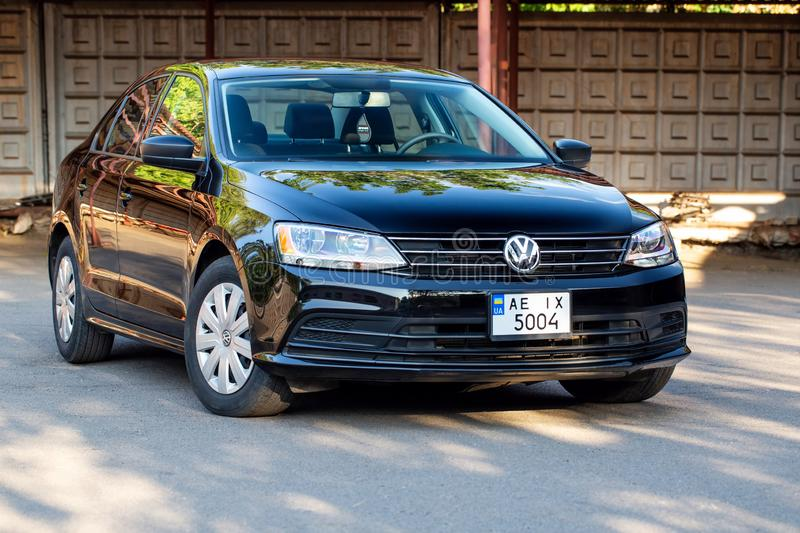 Photo of black Volkswagen Jetta in the yard. KRIVOY ROG, UKRAINE - JULY 28, 2019: Photo of black Volkswagen Jetta in the yard royalty free stock image