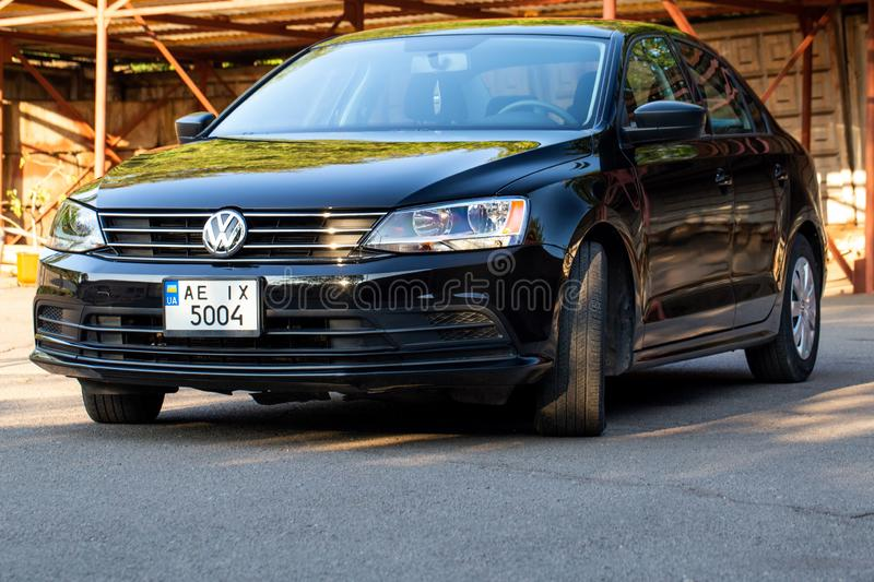 Photo of black Volkswagen Jetta in the yard. KRIVOY ROG, UKRAINE - JULY 28, 2019: Photo of black Volkswagen Jetta in the yard stock images