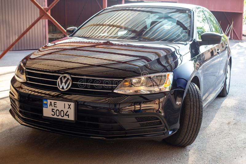 Photo of black Volkswagen Jetta in the yard. KRIVOY ROG, UKRAINE - JULY 28, 2019: Photo of black Volkswagen Jetta in the yard stock photography