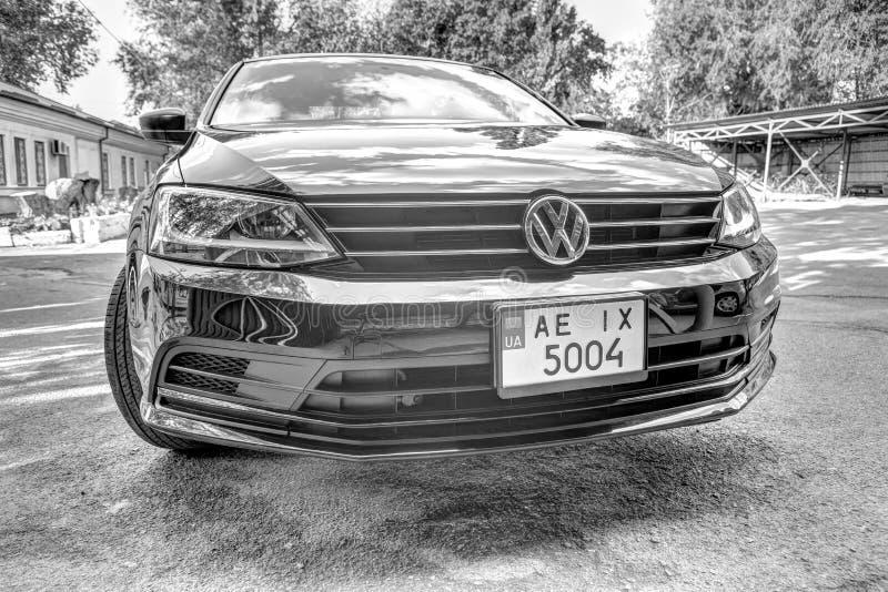 Photo of black Volkswagen Jetta in the yard. KRIVOY ROG, UKRAINE - JULY 28, 2019: Photo of black Volkswagen Jetta in the yard royalty free stock photos