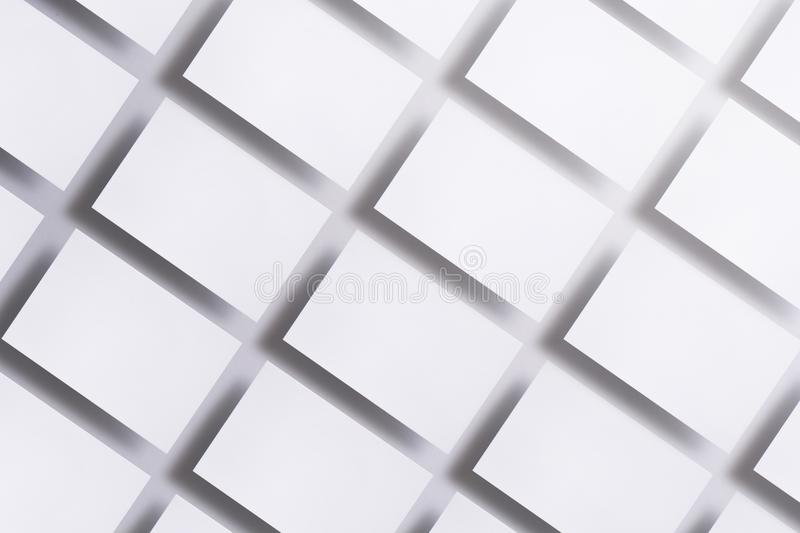 Photo of blank business cards on white. Mock-up for branding identity. For graphic designers presentations and stock photos