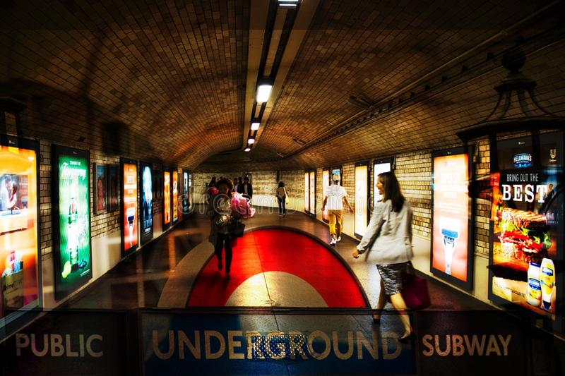 Photo blend of a subway hall in the underground in London England. A picture of a photo blend of a subway hall in the underground in London England royalty free stock image