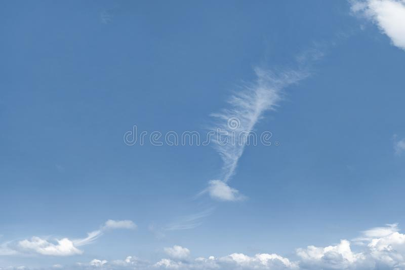 Photo of blue sky with strangely shaped cloud. royalty free stock image