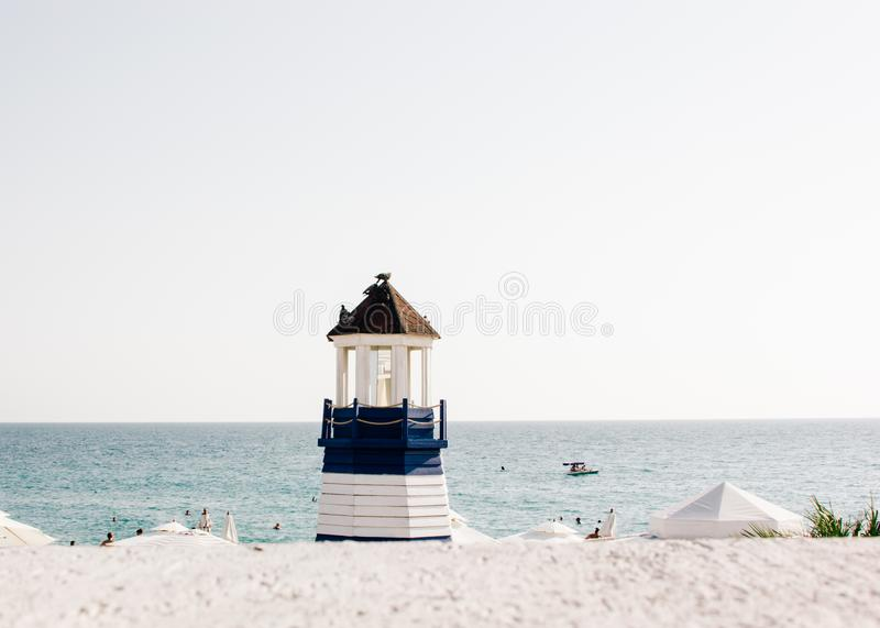 Photo of Blue and White Painted Lighthouse Near the Beach royalty free stock photos