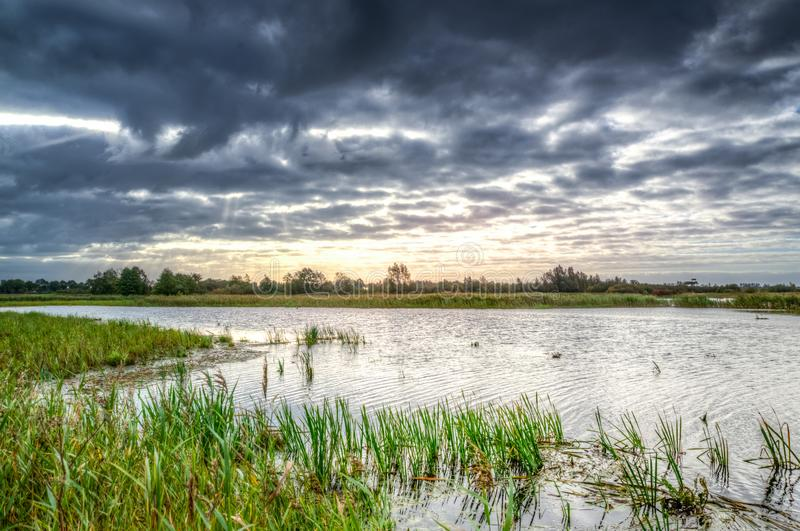 Photo of Body of Water Under Black Clouds royalty free stock image
