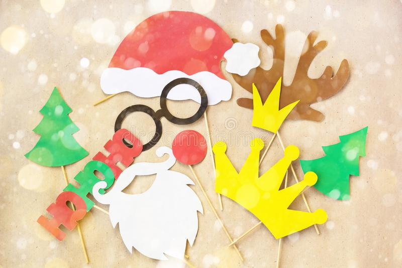 Photo booth colorful props for christmas party mustache, santa claus, fir tree, glasses, crown, antler, nose, hat stock photos