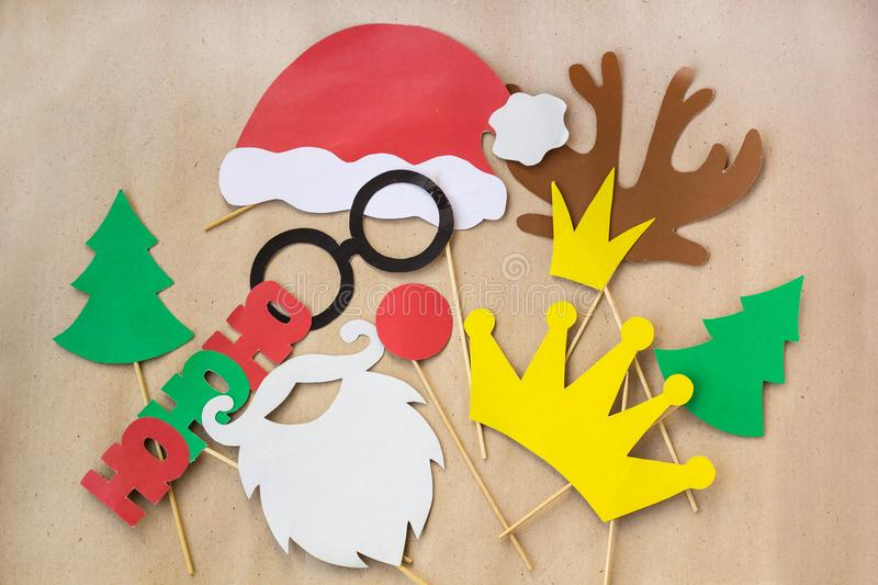 Photo booth colorful props for christmas party - mustache, santa claus, fir tree, glasses, crown, antler, nose, hat royalty free stock photography