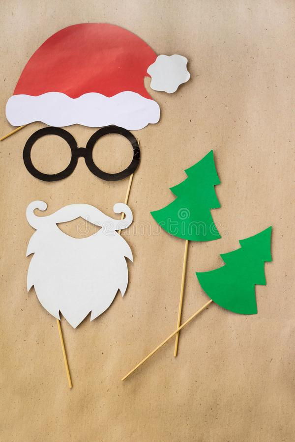 Photo booth colorful props for christmas party - mustache, santa claus, fir tree, glasses, hat royalty free stock image